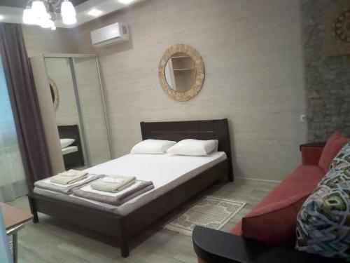 Кровать или кровати в номере Керченский дворик