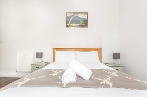 A bed or beds in a room at The Married Quarters