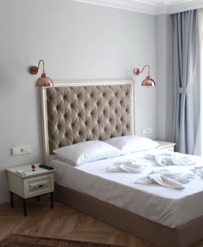 Ένα ή περισσότερα κρεβάτια σε δωμάτιο στο Hotel Cigno Istanbul