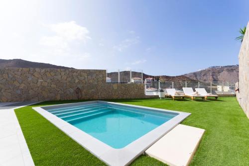 Het zwembad bij of vlak bij ROOFTOP VILLA GRAN CANARIA