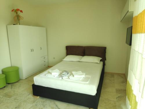 Кровать или кровати в номере Liberty Residence