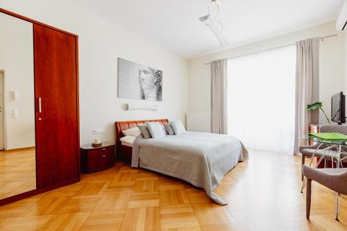 A bed or beds in a room at 4Seasons Apartments Cracow