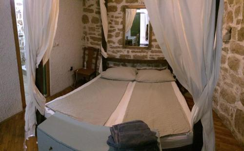 A bed or beds in a room at Apartment Voltera