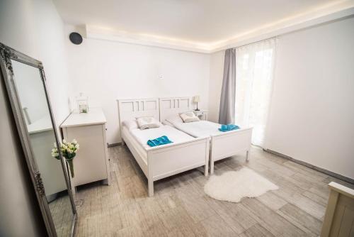 Postel nebo postele na pokoji v ubytování U Ořecha