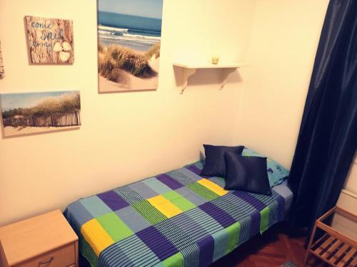 Postelja oz. postelje v sobi nastanitve Apartment above the beach and city center