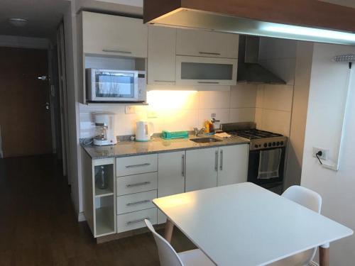 Una cocina o kitchenette en El Descanso