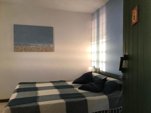 Łóżko lub łóżka w pokoju w obiekcie Cesar Apartamentos