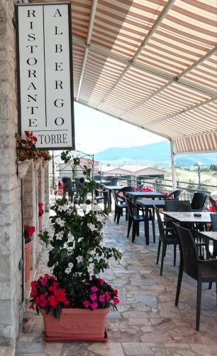 Restaurant ou autre lieu de restauration dans l'établissement Albergo La Torre