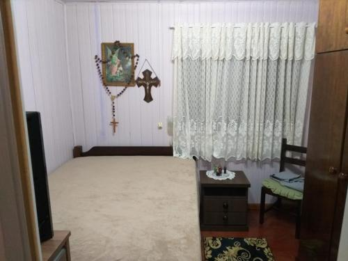 A bed or beds in a room at Casa da Silvia Gramado