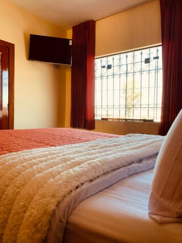 A bed or beds in a room at Plaza Melgar