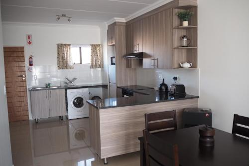 A kitchen or kitchenette at The Willows at OR Tambo