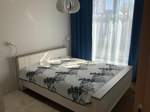 Кровать или кровати в номере Jõe Apartments