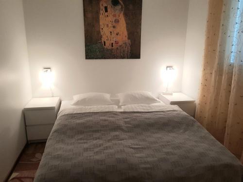 Кровать или кровати в номере Holiday House in Helsinki