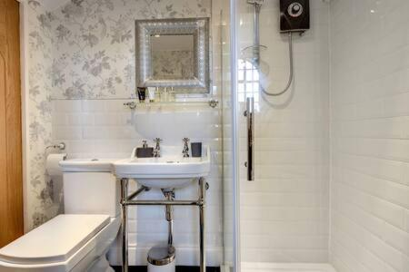 A bathroom at Carnegie Library: Bronte Apartment 1 bedroom