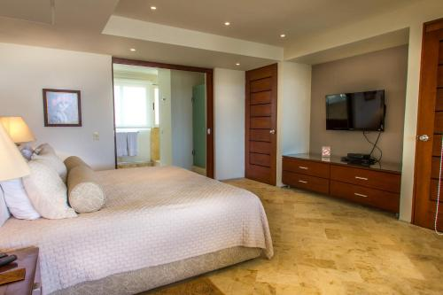 A bed or beds in a room at Magia Playa by BRIC