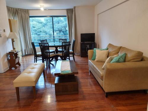Un lugar para sentarse en Apartamento Edificio Milenium