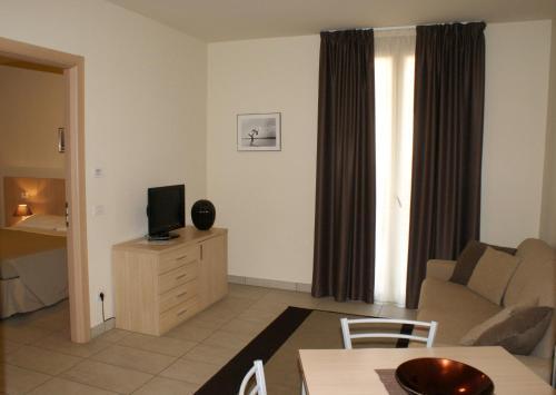 TV o dispositivi per l'intrattenimento presso Residence Belmare