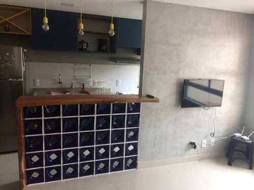 A kitchen or kitchenette at VOG Torres do Sul Ilhéus