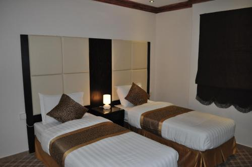 A bed or beds in a room at Nafa Suite Apartment 2