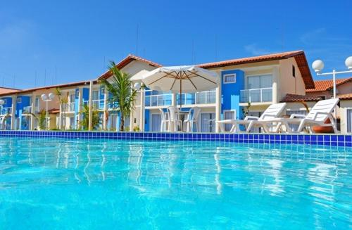 The swimming pool at or near Residencial Mont Sião - Tonziro