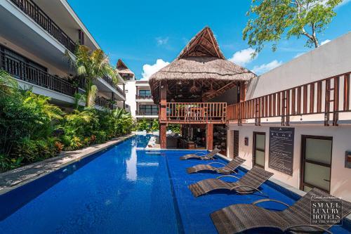 The swimming pool at or near KASA Hotel Parota