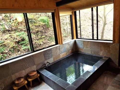 The swimming pool at or near Kurasako Onsen Sakura