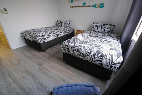 A bed or beds in a room at Sanctuary Beach Retreat