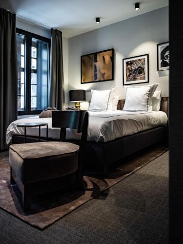 Een bed of bedden in een kamer bij Boutiquehotel 't Fraeyhuis