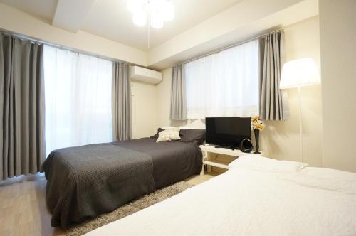 เตียงในห้องที่ CENTRAL OSAKA RIVERSIDE AP 201
