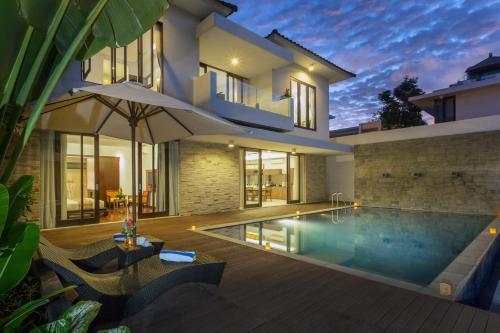 The swimming pool at or near Nagisa Bali Bay View Villas