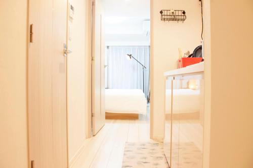 A bunk bed or bunk beds in a room at Shu-shinjuku hotel