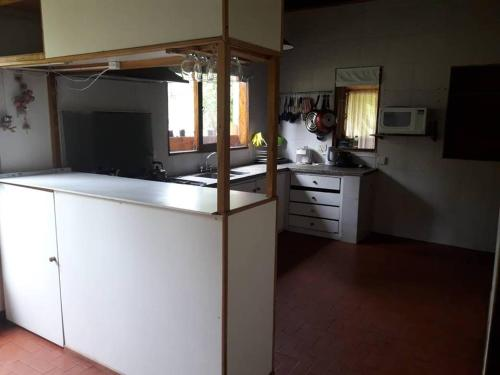 A kitchen or kitchenette at complejo del bosque