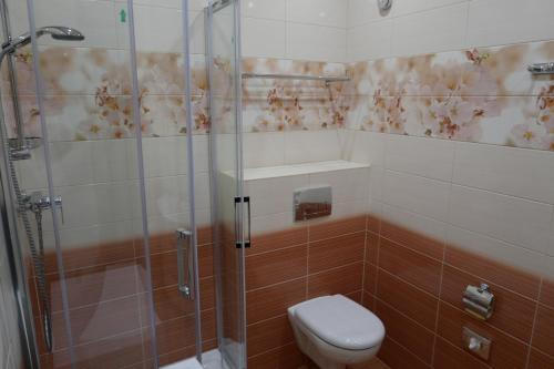 Ванная комната в Апарт-отель Золотая Арка by ORSO