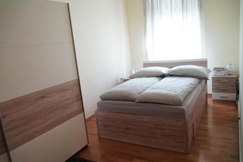 Postelja oz. postelje v sobi nastanitve Apartma Simona