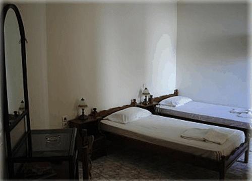 Ένα ή περισσότερα κρεβάτια σε δωμάτιο στο Constantino's Studios