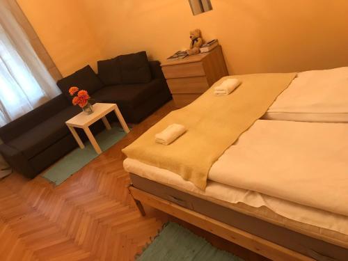 Cama ou camas em um quarto em Blahnikova Aparthotel