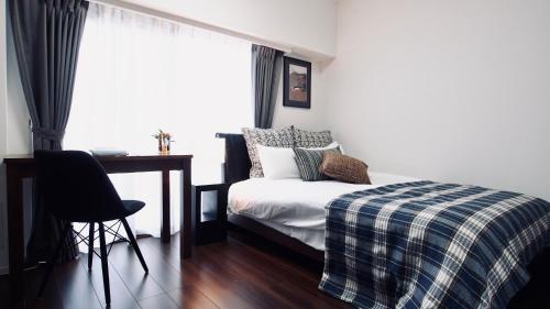 เตียงในห้องที่ Ikegami Sky Garden Apartment