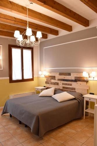 A bed or beds in a room at Venicegreen Agriresort