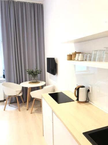 Virtuvė arba virtuvėlė apgyvendinimo įstaigoje Concordia 3