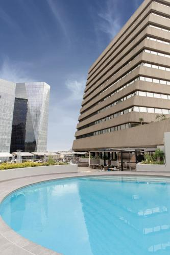 The swimming pool at or close to Sandton Sun