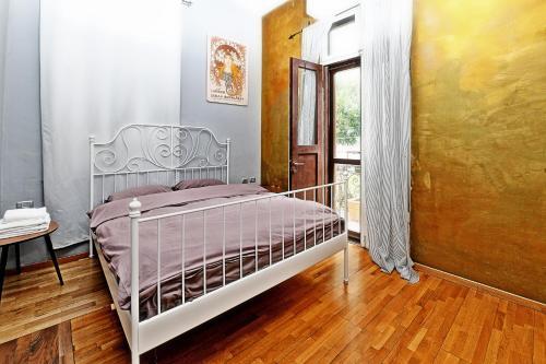 Lova arba lovos apgyvendinimo įstaigoje Eclectic ApartHotel
