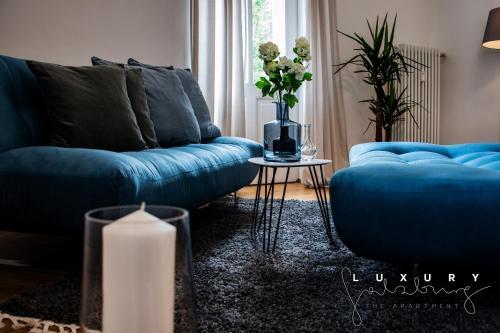 Ein Sitzbereich in der Unterkunft luxury apartment in town