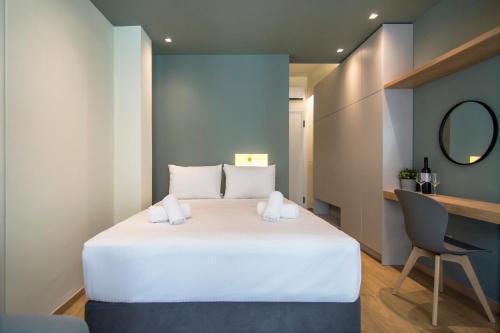 Cama ou camas em um quarto em Boutique Luxury Studios in Athens Downtown