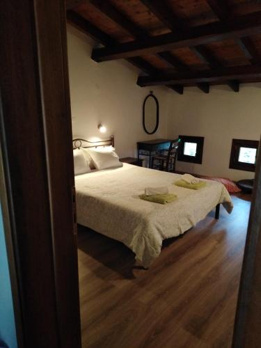 Ένα ή περισσότερα κρεβάτια σε δωμάτιο στο Ελατόδασος