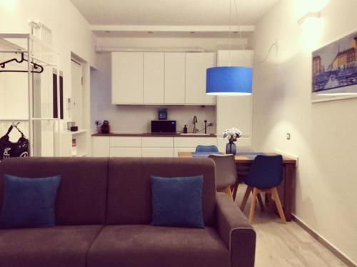 A seating area at Brand new stylish apartment in Navigli Area