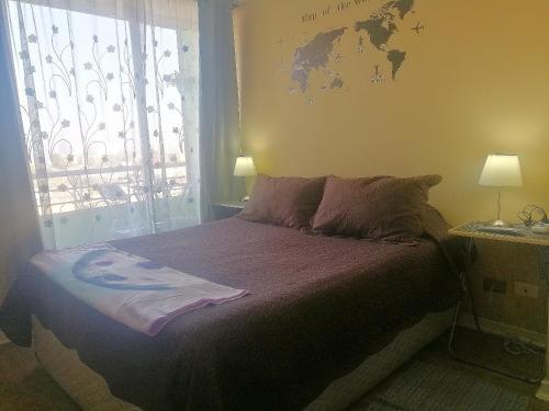 Cama o camas de una habitación en ChileRuca Departamentos Amoblados