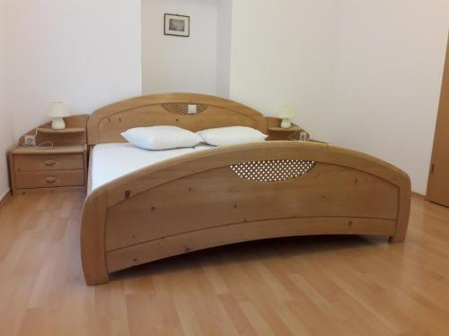 A bed or beds in a room at Luciano apartament