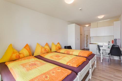 Ein Bett oder Betten in einem Zimmer der Unterkunft Anstatthotel.ch Hochdorf
