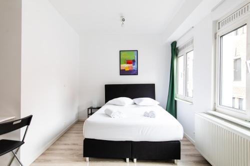 A bed or beds in a room at Flat in the heart of Antwerp Centrum