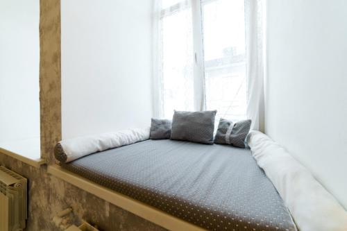 Кровать или кровати в номере Апартаменты Personnage